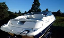 This 22 foot Glastron GS219 Cuddy Cruiser is in excellent condition, very clean and barely broken in at 90 hours (three of the summers not put in the water). Engine is a Mercruiser 5.0 L, 260 HP - this is a fast boat. The Deep Vee hull handles the big