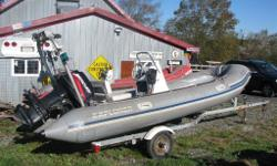 1999 Bombard inflatable boat with 50 horse Mercury outboard! Complete with center consul and trailer!