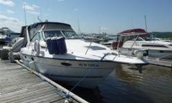 White with blue and grey trim, electric anchor,bow thruster, full kitchen, new fridge, bathroom, indoor and outdoor shower, bbq,, boat cover 5 years old. Sea to land radio, ipod docking station