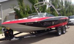 Boat is in mint shape with only 140 hours on it. Red, Black and White coloring with a 350 monsoon motor. 6.5' touch screen control with Malibu launch system, STE silent tip exhaust. V-drive system, Illusion G3 tower with Malibu spinner combo fork racks,