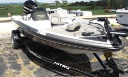 This bass boat was a recent trade in. It has a trolling motor and a 90 hp outboard.