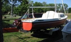 new fully batten main; two roller furling headsails (jib&genoa); Harken jib leads; sound trailer; mercury 2.5 ; perfect cottage boat, swing keel/beach-able; Best Offer takes her !