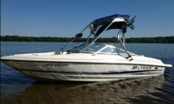 LARSON SEI 180 in great condition ROSWELL wakeboard tower w/ wakeboard racks (4 boards), wakeboard mirror, speakers (4), PIAA Fog Lights (2), Bimini top on tower AM/FM CD radio with 4 waterproof speakers (8 total) amplifier to power the tower speakers