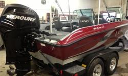 Mercury 200 hp Verado, tandem bunk trailer, complete stand-up top, smartcraft guages, 4-pro ride seats w/air ride, sports package (ski pylon, snap in carpet, travel cover), bow bolsters, 3-bank charger, keel guard, Lowrance HDS-7, Minnkota 80lb Terrova