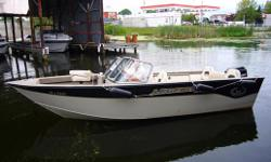 LEGEND 195 XCALIBUR WITH115 hp Mercury and trailer. Deep hull, full windshield. All welded aluminum construction. Complete with original full top, front cover (bow), and travel/storage cover. Vinyl lower floor. Carpeted bow, with retractable bench, 2 live