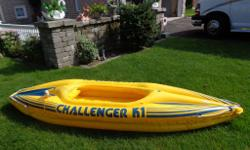 This inflatable Kayak is in good shape. Holds a person up to 90 kg. well. Is a lot of fun and performs well. Comes with 2 small Paddle's.