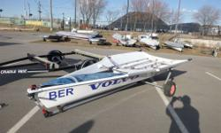 29er skiff sailboat and cradle ride trailer. Boat and sail #1415. Manufactured in 2007. Well maintained boat and includes all parts, sails, dolly and trailer.