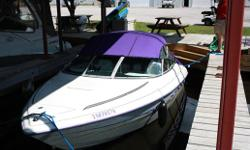 1998 Starcraft 2010 GT Cuddy: Powered with a Mercruiser 5.0 engine w/ Alpha Drive. Professionally maintained and in excellent condition. Comes with quick and quiet exhaust, convertible bimini/full enclosure, cockpit cover, bucket seating with full rear
