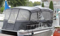 Beautiful black Bennington GL 2075 pontoon, full camper (1 year old), binini top, BRP Evinrude E-TEC115 HO, Elliptical package (larger pontoon), privacy enclosure, chemical toilette, bar sink, retractable tow pole, ladder, upgraded captain chair, CD/MP3