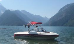 2007 Tige 20V wakeboard boat - 210 hours - 5.7 l engine; 350 hp; collapsible tower, board racks, Tige cruise control, cover, trailer with removable tongue, CD w/ipod hook up. Garage kept. This boat is loaded. Trailer included. $52,000.00 OBO.