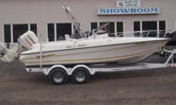 Description: Very stable Center Console with plenty of features to please the whole family. The 200 hp Evinrude runs great and includes a stainless prop as well as a modular prop with replaceableblades. The large center console has a sliding door and is