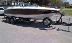 Great runabout for the cottage or trailer to your favorite lake! The boat is very well equipped with a Custom, Heavy Duty Heritage trailer, Volvo 5.7L Gi power with Duoprop, bimini top, snap out carpet, extended platform....all with only 168 hours! Just