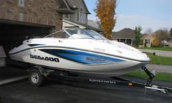 2006 4 Tec SeaDoo Challenger 180CS, White/Blue in colour This boat has a sun deck, swim platform with retractable ladder, built in coolerk, AM/FM stereo with CD player, 215HP motor and Baimini Top This boat can go 52 mph and is great for tubing,