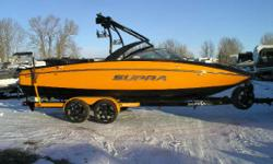 CALGARY 420 HP Indmar V-Drive Engine, Progressive Tower, Black Bimini Top, Dual Battery with Charger, Heater, Underwater Lighting, Tower Speaker/Light Bar and BoatMate Tandem Axle Trailer with Matching Orange Fenders, 18 Wheels and Illuminated Laser Cut
