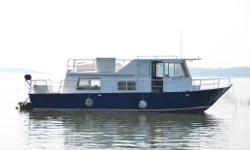 1973 Alcan Seavilla 300, 32' long house cruiser with aluminum V-hull with 2 Volvo Penta gasoline engines 165 hp each with Volvo Penta outdrives ? NEW SURVEY with value estimate of $30k located in Victoria Harbour, Ontario, Canada more photos at
