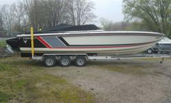 1987 Formula 311 SR1 Trs drives and tranny's. Great boat. Very reliable and looks great. 3 axle aluminum trailer included.