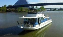 46.0' CHRIS-CRAFT AQUAHOME CRUISER 1984, 8 pass, gas, White with marine blue ext, tiller, 46 Ft Chris Craft - twin cabin each with en-suite bathrooms. Sleeps 8 walk around decks, full kitchen with stove/oven, microwave, dishwasher/ washer/dryer combo.