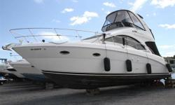 White Hull with Black Full Camper Canvas in great condition. Bow Thruster and Stern Thruster - with Remote Control RayMarine E120 Chartplotter Remote Stereo Clarion CD Player with 6 disc changer Mercury Marine Smartcraft guages Northstar VHF Radio Tilt