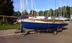 Rare wooden wayfarer for sale. Made and designed in England,solid boat but needs refinishing. All parts are there. Including extra centerboard. Trailer included.
