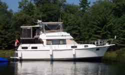 Just reduced from $38,500! Well maintained vessel. Hardtop with wing doors. Spacious aft cabin with queen island bed, built-in dressers/vanity, closet, & full ensuite bathroom. Sleeps 6 comfortably, with 2nd bathroom near forward cabin. Full kitchen,