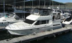 Beautiful, well maintained Carver 405 Aft Cabin Motor Yacht. This is a conservative and spacious model that offers an enticing blend of comfort and value. It has an expansive galley down approach with a dinette and boasts a huge salon with double