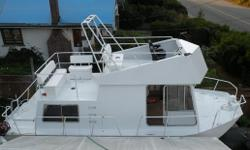 The hull is from a ALCAN 290 series built in 1968. The boat has been rebuilt entirely out of Aluminum for structural support for passengers on the upper decks. The upper decks can seat up to eight people in comfort. Both upper decks railing are at 38