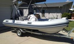 2013 Highfield Ocean Master420 13.9ft Inflatable boat constructed with aluminum hull and hypalon tubes. Half the weight of other competitors and just as much boat only weighing 331 LBS. Powered by a 50hp Yamaha outboard and loaded with extras including