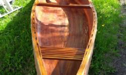 Vintage canoe made in Trout Creek, needing some TLC!! call 705-264-2063 or 705-221-0541, asking $600.00 OBO!!