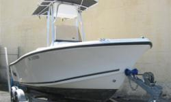 LOW HOUR ONE-OWNER BOAT. INCLUDES TANDEM EZ LOADER ALUMINUM TRAILER WITH DISC BRAKES.