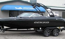 Beautiful shimmer black metallic with luxurious interior, concert package sound upgrade with tower speakers, dual battery system, sea deck flooring, zero off wakeboard GPS speed control, wake surf rack with rotating blocks, supertanker ballast system, 3