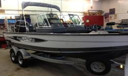 with Mercury 200 HP Verado and Shoreland'r galvanized bunk tandem trailer...comes with standard equipment plus complete stand-up top, vinyl main floor (with snap in carpet), cockpit cover, 1-pilot chair, 3-pro ride seats w/ air ride, bow multi base,