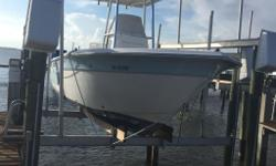 Immaculate centre console fishing boat with polished aluminum canopy and bimini top, stainless rod holders, Suzuki 140 four stroke outboard w stainless steel prop, Lowrance GPS with transom mount transducer, live well, full console cover, upgraded swivel