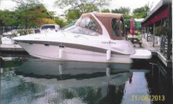 white with tan & blue accents, tonneu cover, brand new sunbrella convertable top in 2013, sterndrives duo prop, new fenders and mooring lines in 2013, new bottom paint in spring 2013, rebuilt and overhauled stern drives in spring 2014,total length is 31'