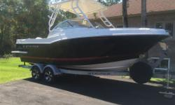 Prestine condition 2014 Striper boat with all bells and whistles. 2014 Evinrude 225 HP outboard engine with a 2014 Evinrude 15 HP kicker motor. 2014 custom Shorelander trailer with spare tire. Snap in mat. Flip up bench seat. Colour band black. Tan