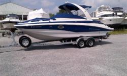 WOW! Amazing deal on a late model low hour Crownline! Compare a new package at $118,000! This one includes the galvanized tandem trailer, just hook up and go boating! Save over $40,000 from a new one! Includes Raymarine Hybrid Touch GPS and Raymarine VHF.