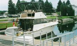1987 Trojan F-32 Fly Bridge Sport Fisherman.  Pristine condition inside and outside. Upper and lower operating stations.  Fully loaded with operating and navigational equipment.  Excellent cruising and fishing boat for Great Lakes or River travel.  All