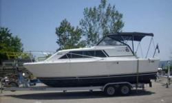 1980  25ft trojan  new sunbrella top Engine is a good running  350 MerCruiser 228 hp and has a velvet drive marine transmission nice cabin inside the boat and it has a refrigerator, microwave, sink, toilet,  tv   boat is in water   no trailer