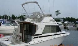 The legendary Bertram 33 Flybridge Cruiser with the rare dual station option, powered by Mercruisers rebuilt in '06 with only 60 hours on each. Large private forward cabin with hanging locker Head equipped w/electric toilet, sink and shower Large salon