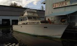 1967 36' Trojan Sedan Flybridge - engines run, needs some TLC. Currently in water.  Call for more details.