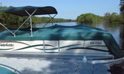 Loaded Sweetwater Pontoon boat in excellent condition. Playpen cover, cabana with screens, convertible canopy, deluxe helm chair, bow chaise lounge (2), changing room with pota-potti, GPS, Overnight camping tent (new 2014), Seadoo towable 3 man tube (new