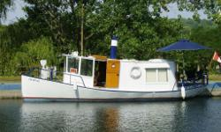 The Lady Ann, formerly Entropy, a unique steel hull Victorian Launch, originally a wood-fired steam boat, now powered by a reliable 27 hp 3 cyl. Yanmar diesel. Runs all day on the whiff of oil from a greasy rag. Built in 1979 to a 1923 design. Ideal for