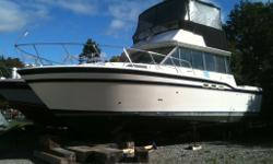 Bring offers!!! JUST REDUCED, Custom Flybridge needs your finishing touches. $5000 recently spent on bridge enclosure. Twin 454 MerCruiser inboards, features wide beam and sliding patio doors to the custom salon area and interior.