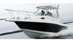 "The 2301 Walkaround is bigger and better than most boats her size in almost every way. Two 92-quart fish boxes, a 30-gallon live well, a 25-inch gunwhale freeboard, 135-gallon fuel capacity and 6'0"" of headroom in the cabin are just a few of the ways"