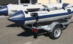 "10'9"" Rigid Hull inflatable boat. Price does not include trailer. Boat was only used once. Sold the ""big"" boat and no longer have use for this dinghy. Excellent quality boat made in Korea - not in China. Made with 1100 denier PVC. Comparable, if not"