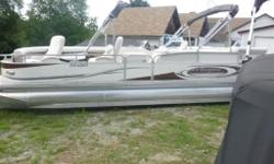 2009 Manitou Legacy, 26', F115 Yam,aha four stroke, full enclosure, double bimini top, 2 reclining captains chairs.