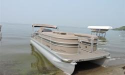 "A luxury pontoon with lots of room. This boat is in excellent condition and has had minimal usage. There is a change room, three ""lounges,"" a table and a coffee table/cooler. The LTD model includes an 11' Bimini top, pristine helm, Sony CD stereo with 4"