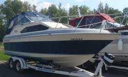 This boat had a favourable survey done in 2010. The canvas is in decent shape and it is powered by an OMC 5.7 that has been serviced regularly. Includes a pump out head, GPS chartplotter, stereo, and safety gear. Includes a tandem axle EZ Loader roller