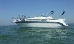 1990 27 foot Carver Montego cabin cruiser. Full cabin with galley (electric and alcohol stove, fridge, microwave, eating area), head with shower, storage, carpeted interior. Sleeps 5. Full camper top (navy blue). 450 cubic inch V-8 engine, Mercruiser