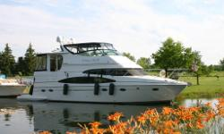 The Carver 466 Motor Yacht is known for its excellent interior accommodations. Elevating the side decks, Carver designers were able to give this yacht an enormous full-width salon whose dimensions rival your average 55-footer. The raised walk- a-round