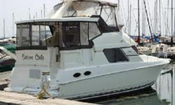 1997 Silverton 372 Motor Yacht  This great aft cabin cruiser/motor yacht boat has a complete bridge enclosure and the hard top over the aft deck area. This boat has an extended swim platform so the LOA is 40ft 6in. This is a big boat! This boat is loaded